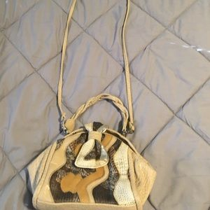 Vintage Colorful purse closes with bow like snap.